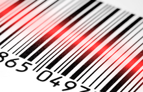 A bar code has a red line of light across it indicating that it is being scanned.