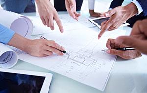 Engineers reviewing schematics.